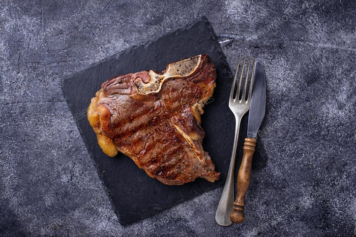 Grilled T-bone steak on slate board