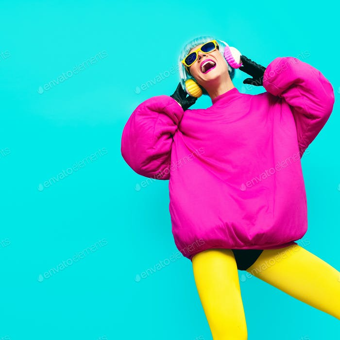 Glamorous fashion model in bright clothes on a blue background l