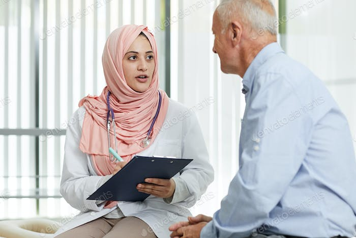 Middle-Eastern Doctor Talking to Patient