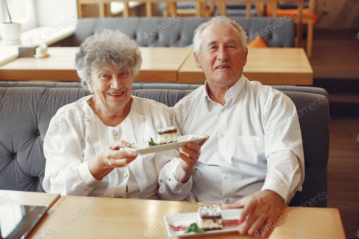 Beautiful old couple sitting in a cafe