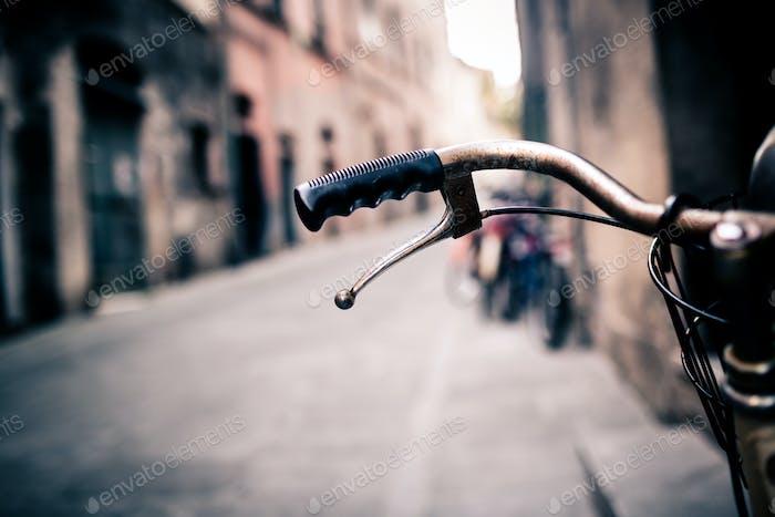 City bicycle handlebar, bike over blurred background