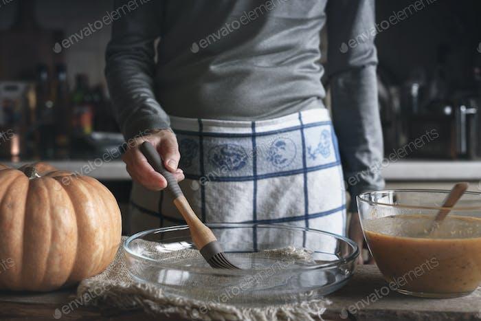 Oiling the backing dish for pumpkin dump cake