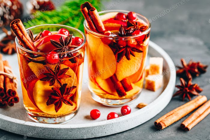 Apple cider mulled wine hot toddy or christmas punch in glass with fruits and spices