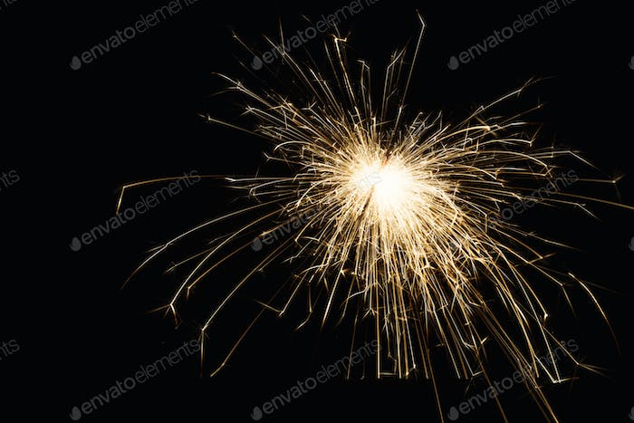 Thumbnail for New year party sparkler closeup on black background