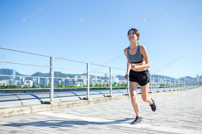 Young Woman enjoy city running