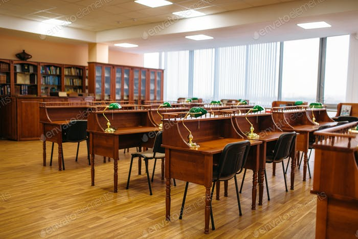 Empty reading room, tables in library, nobody