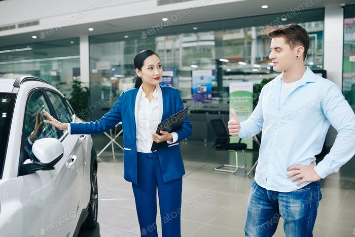 Manager showing automobile to client