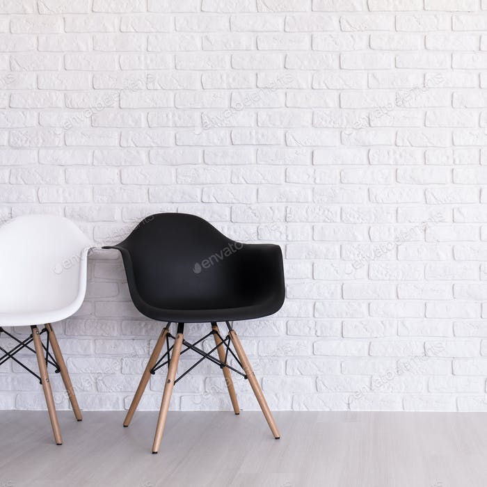 White and black chair in light interior