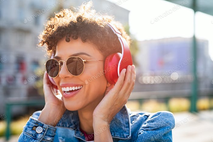 Happy african woman with headphones