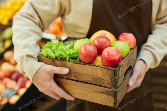 Unrecognizable Man Holding Box of Fresh Fruits and Vegetables