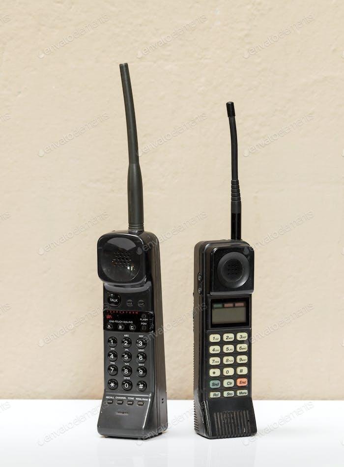 Two old black vintage mobile phones