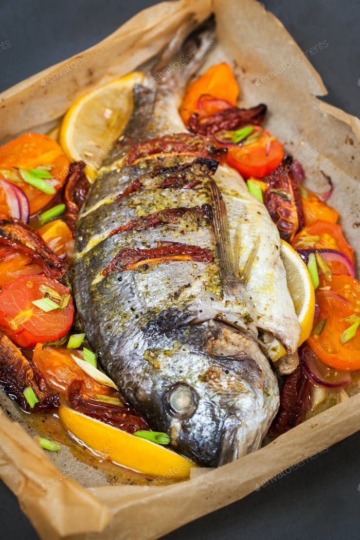 Oven baked whole sea bream fish
