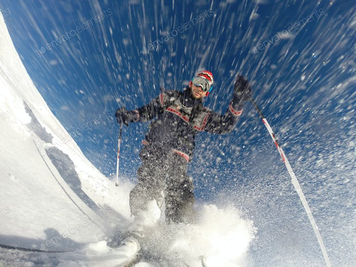 Downhill alpine skiing at high speed on powder snow.