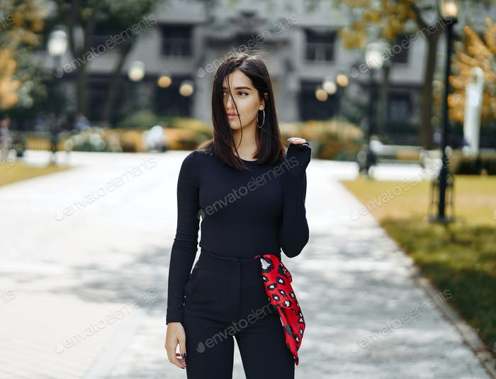 stylish girl walking through her school's campus