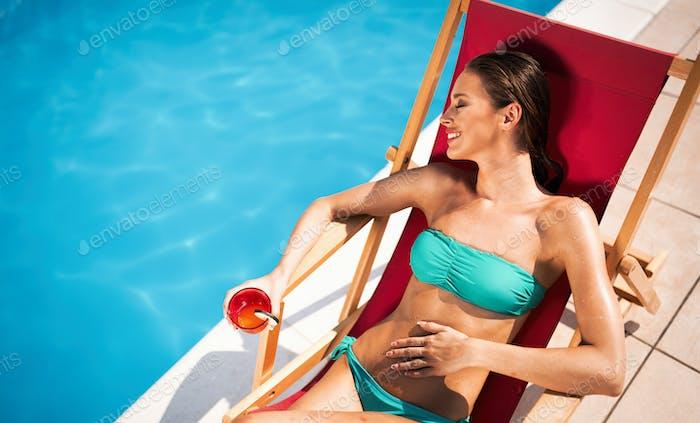 Beautiful woman enjoying summer and tanning