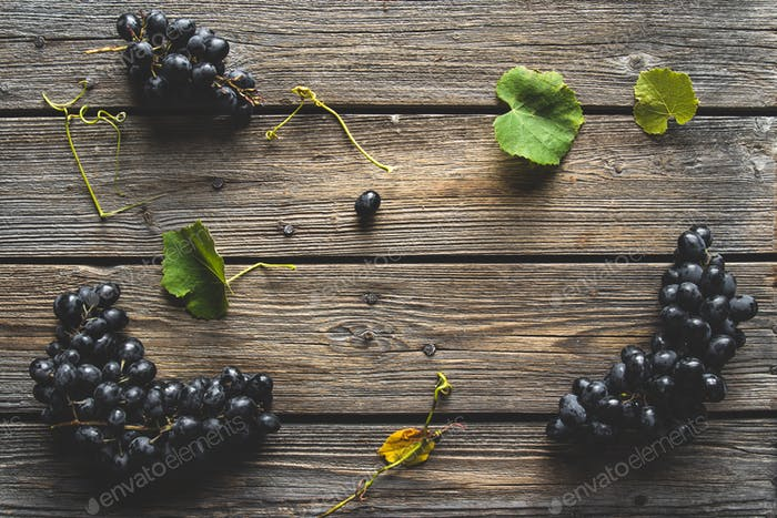 Grapes on a old wooden table. Blue grape