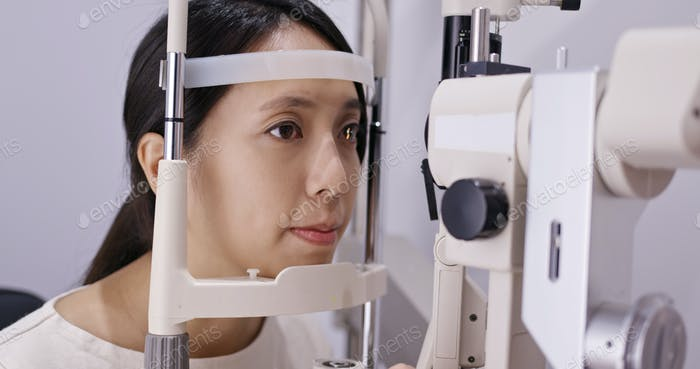 Young Woman check on eye at clinic