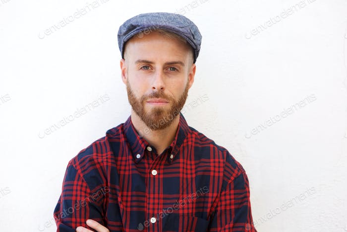 handsome young man with hat against isolated white background