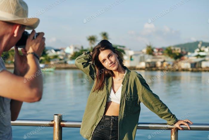 Man Taking Photo Of Woman