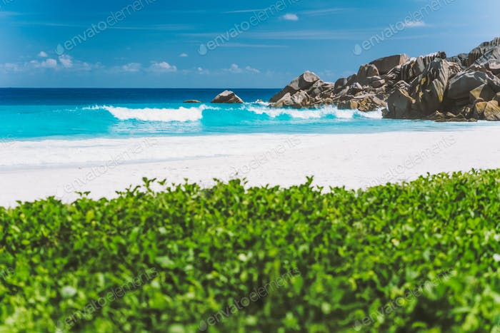 Grand Anse beach, with blue colored deep waves at La Digue Island, Seychelles