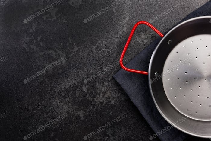 Paella Pan on Dark Background, Top View with Copy Space