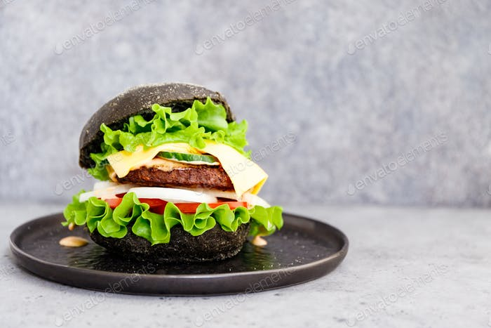 Black burger with marble beef patty