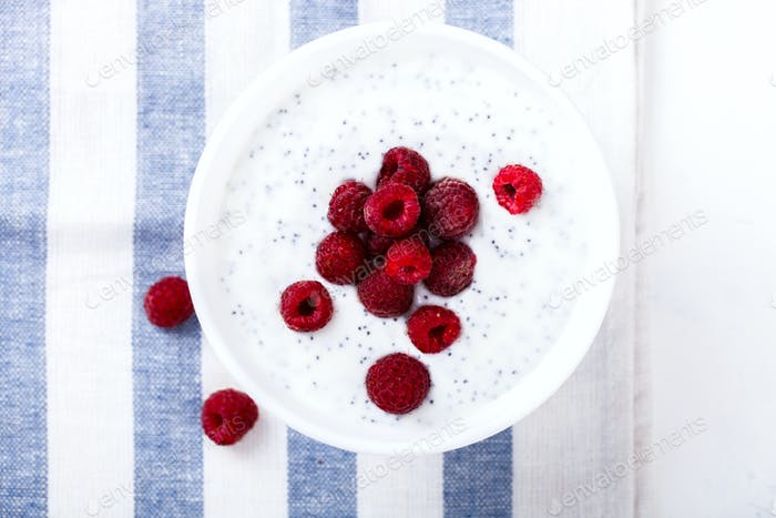 Yogurt with Chia seeds and fresh Raspberries Breakfast.