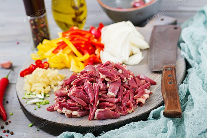 Ingredients for cooking stir-fry from chicken hearts, paprika and onions. Chinese cuisine