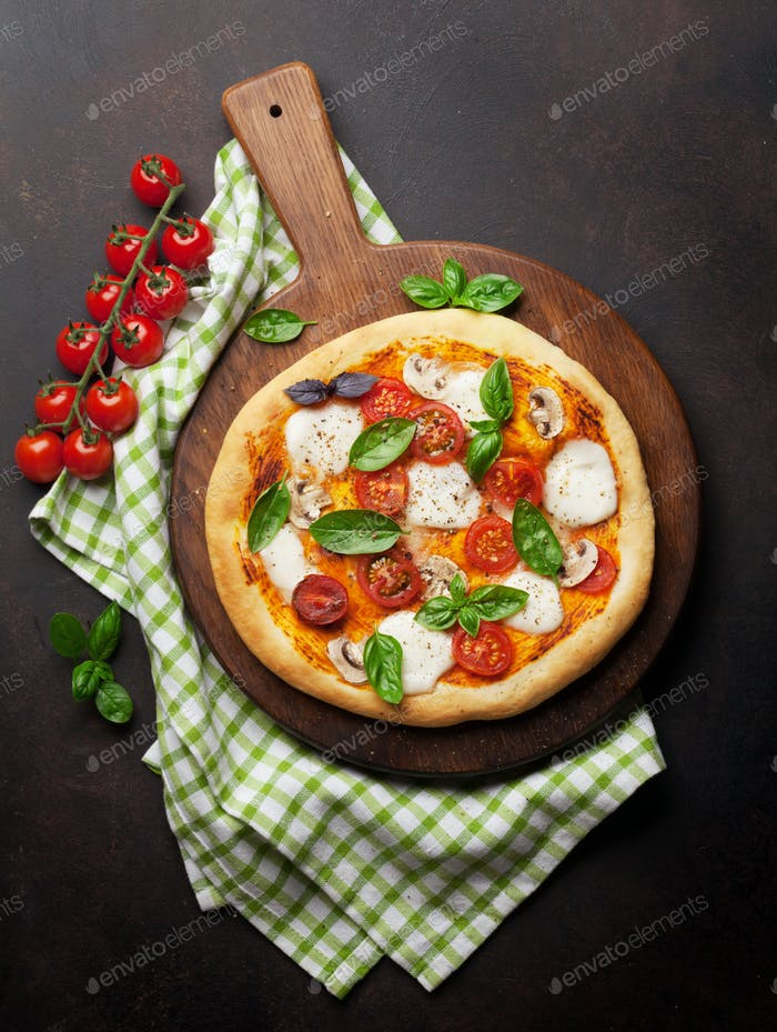 Italian pizza with tomatoes, mozzarella and basil