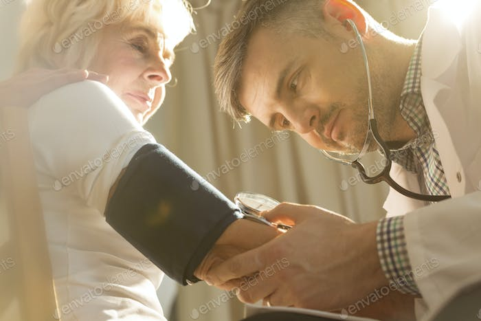 Physician checking blood pressure