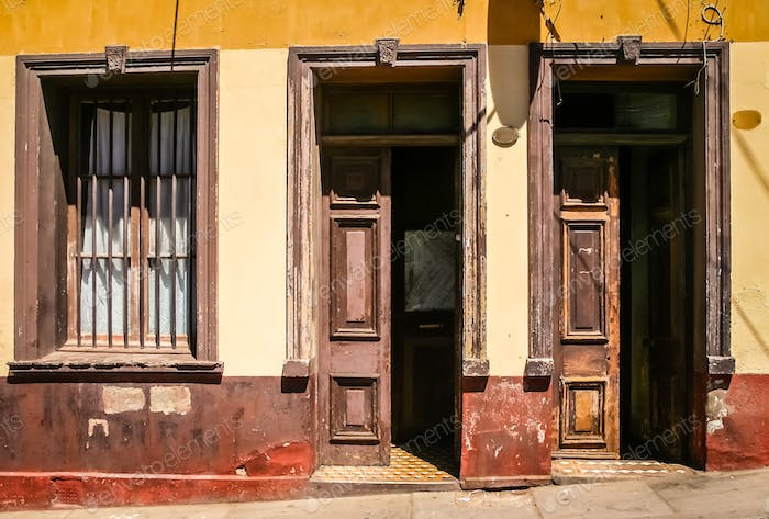 Open wooden doors to old tenement house in Valparaiso