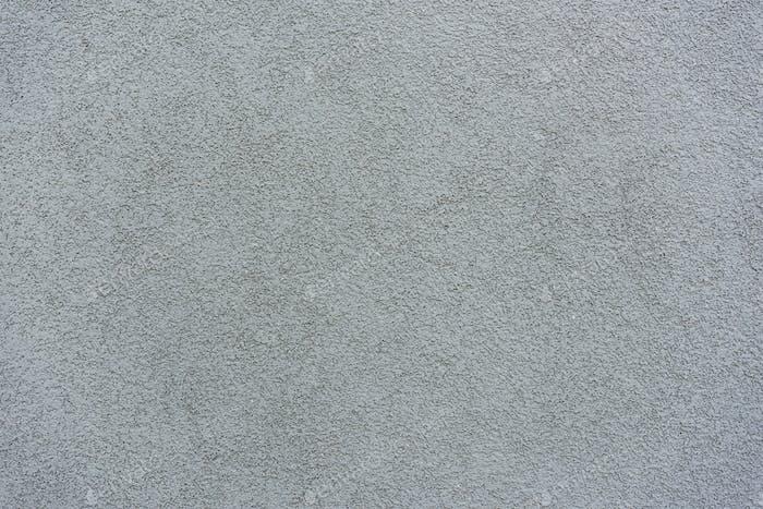 Alter grauer Putz auf Wandhintergrund