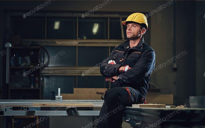 Carpenter male in a workshop.