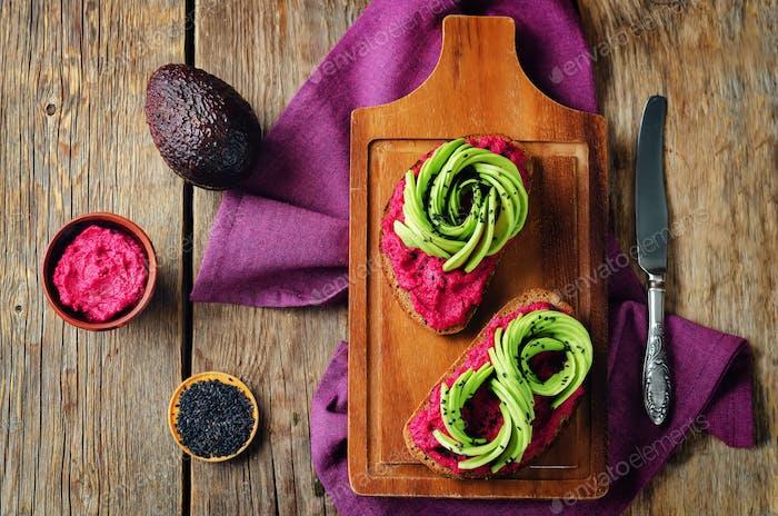 Healthy beet hummus avocado rye breakfast sandwiches