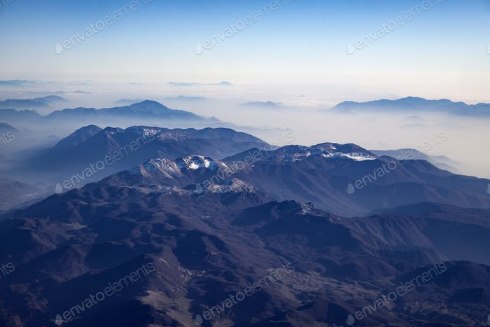 Aerial view of alps mountains covered with snow.
