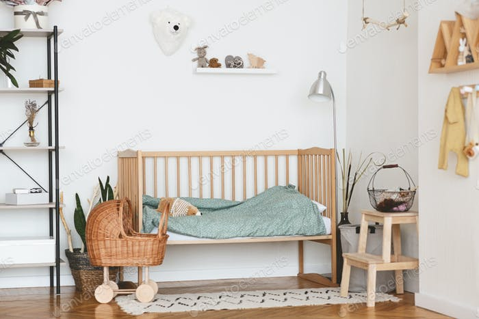 Baby Bedroom Interior with Cozy Wooden Bed And Wicker Stroller
