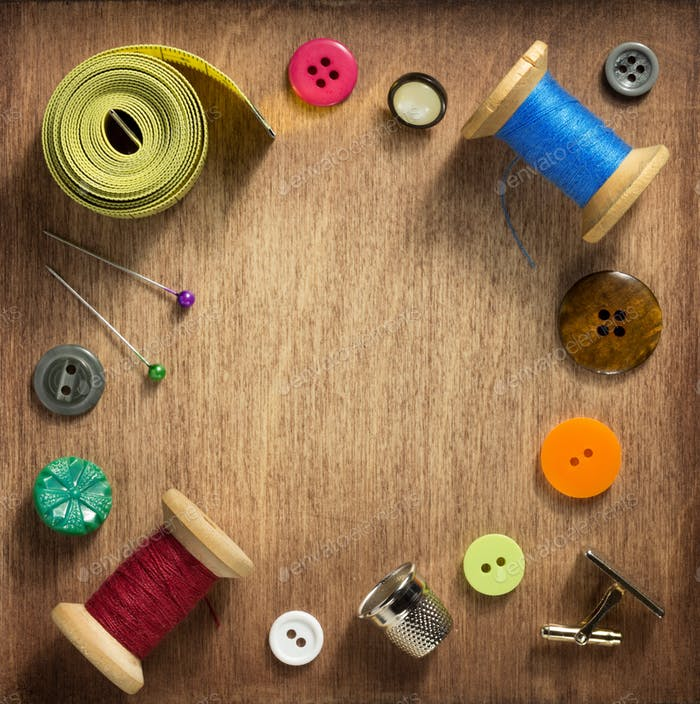 sewing tools on wooden background