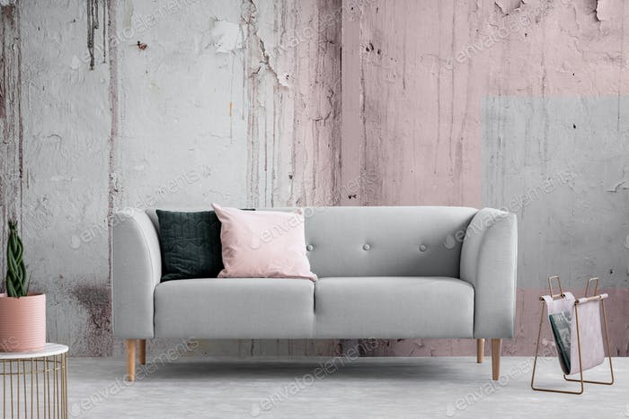 Wabi sabi living room with shabby grey and pink wall, real photo