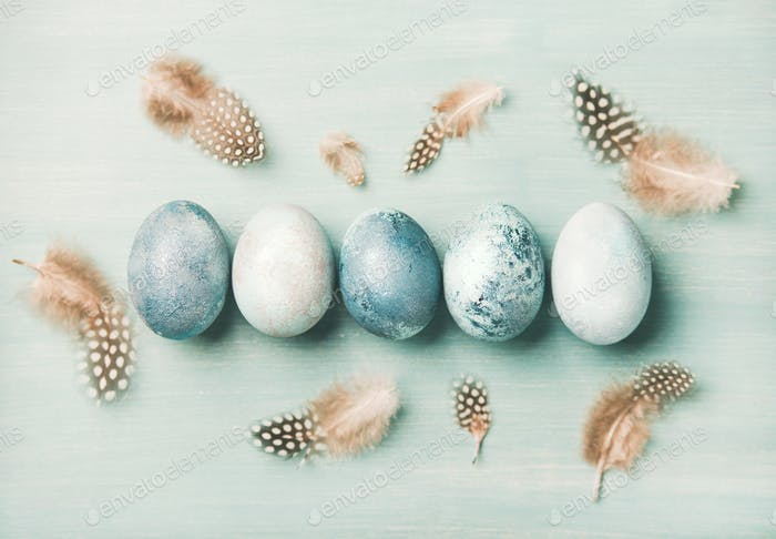 Painted traditional eggs for Easter holiday with feathers, horizontal composition