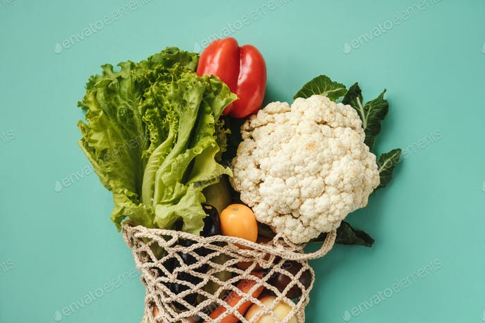 Various fresh food - vegetables in eco-friendly bag.