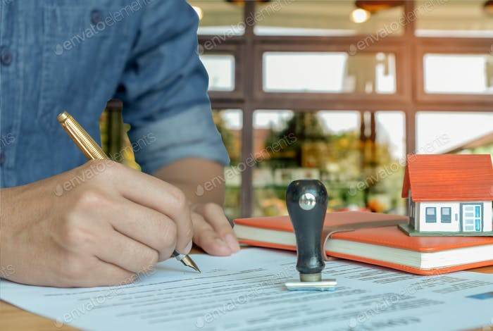 Pen handles signed documents with rubber stamp.