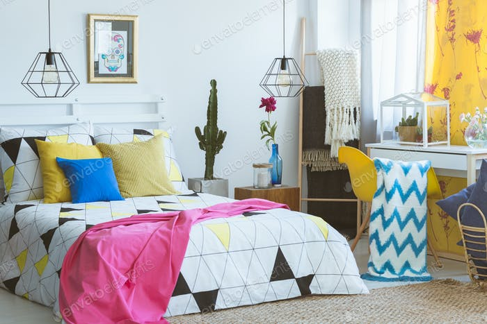 Colorful bedroom with glass terrarium