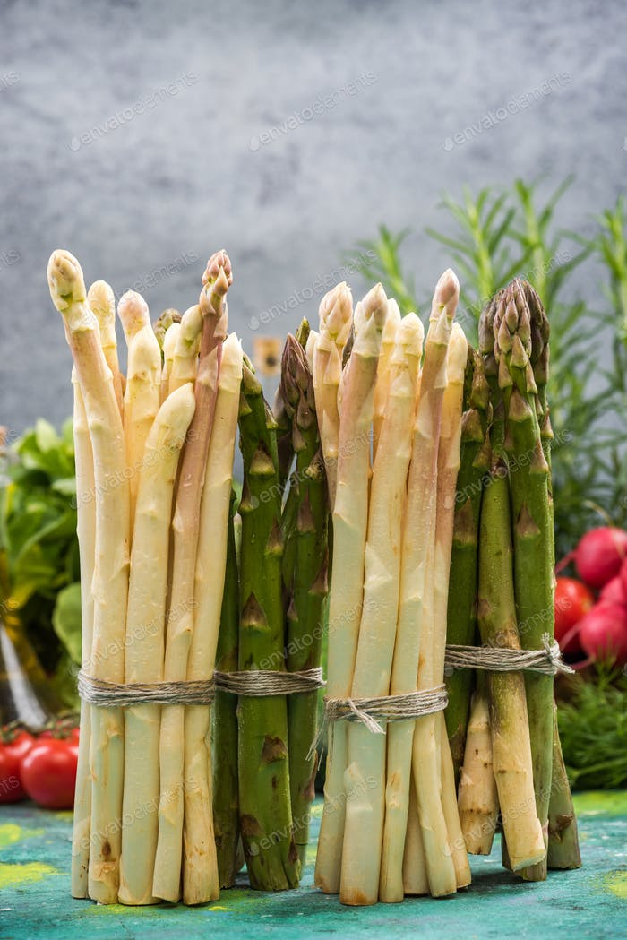Bunch of asparagus standing on kitchen table