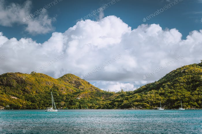 Yacht boats near an uninhabitable island near Victoria city, Mahe, Seychelles