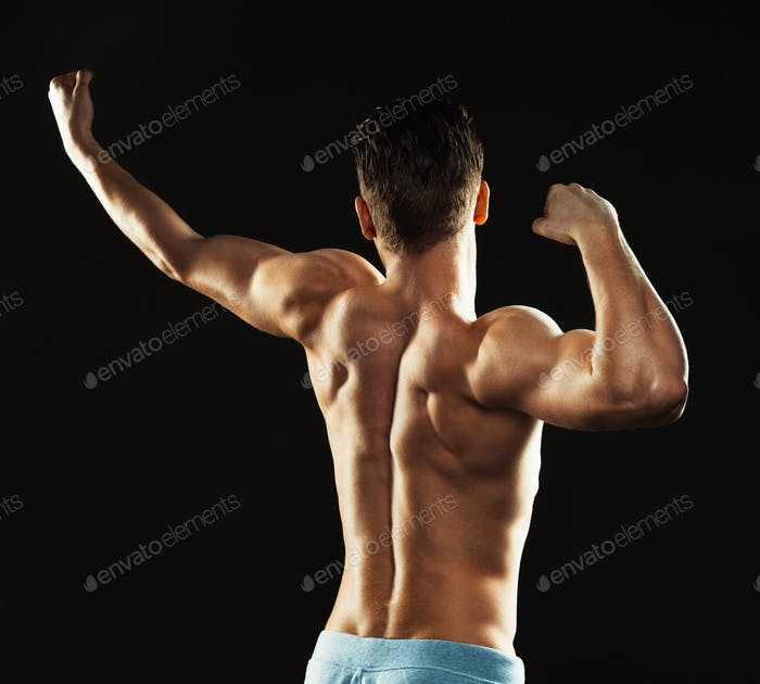 Athletic man on the black background