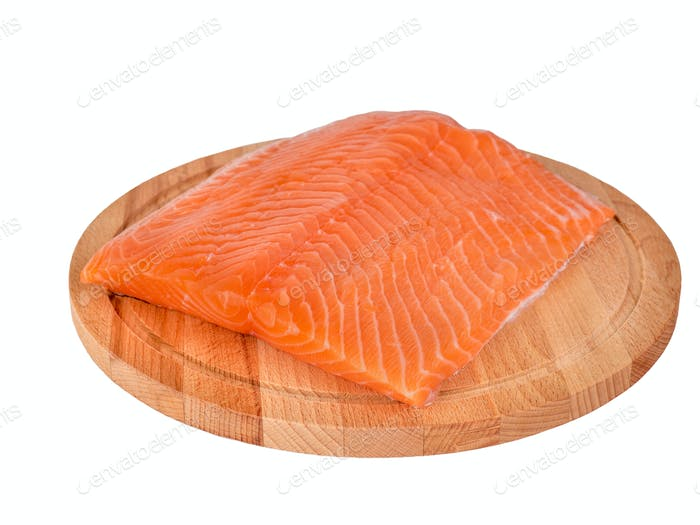 Fresh salmon fillet on wooden cutting board on white background, side view