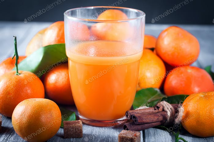 Healthy mandarin juice on wooden table
