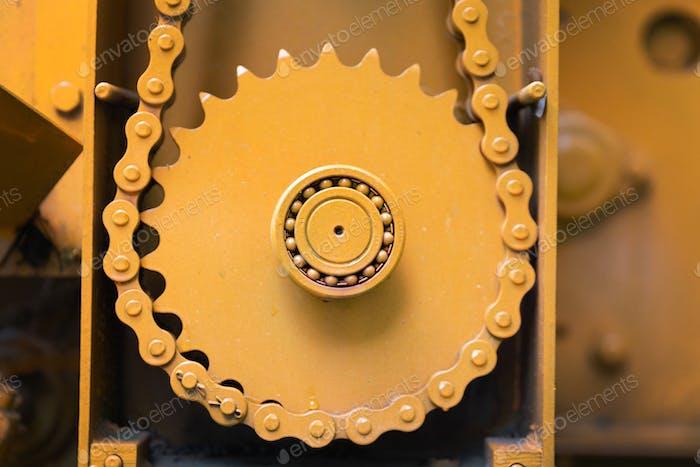 Closeup of orange gearwheel