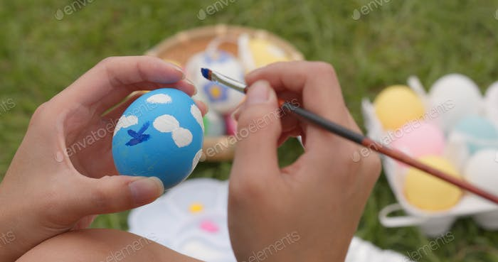 Painting on egg for Easter holiday