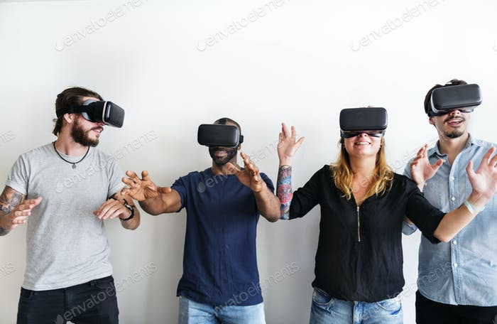 Group of divese friends experiencing virtual reality with VR hea